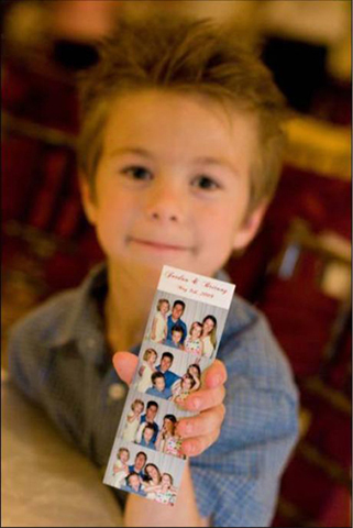 boy holding photo booth pictures